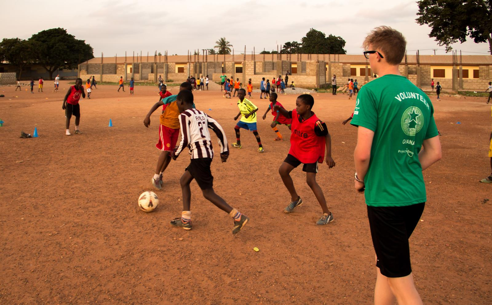 A sports player gains experience through volunteer soccer coaching in Ghana.